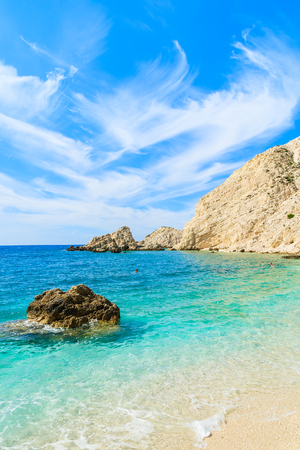 View of crystal clear turquoise sea with rock cliffs on Kefalonia island beach, Greece Stock Photo