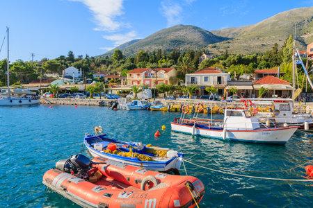 AGIA EFIMIA PORT, KEFALONIA ISLAND, GREECE - SEP 18, 2014: red pontoon boat mooring in port of Agia Efimia. This coastal village is very popular among tourists sailing between Greek islands.