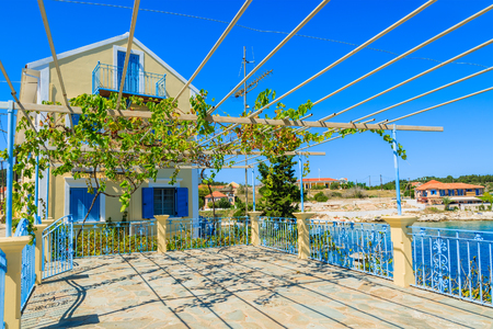 Traditional greek house with vine growing on terrace in Fiskardo village, Kefalonia island, Greece