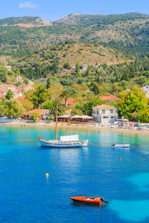 Colourful houses of Assos village and boats on sea, Kefalonia island, Greece Stock Photo