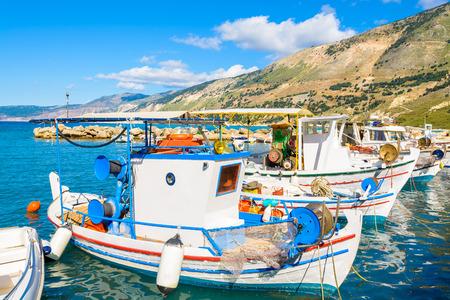 Traditional colourful greek fishing boats in port of Zola village, Kefalonia island, Greece