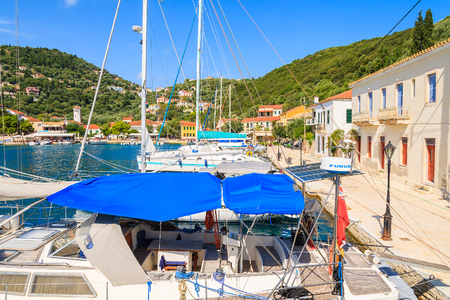 KIONI PORT, ITHACA ISLAND - SEP 19, 2014: yacht boats mooring in Kioni port. Greek islands are popular holiday destination in Europe.