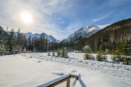 Wooden fence in winter landscape of Tatra Mountains near Morskie Oko lake, Poland Stock Photo
