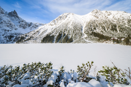 Covered with snow beautiful Morskie Oko lake in winter, High Tatra Mountains, Poland