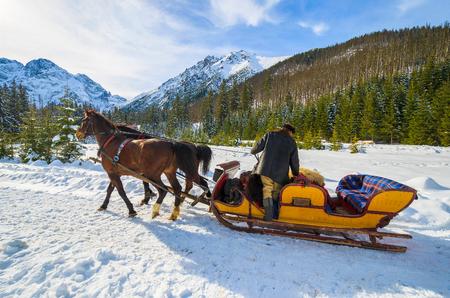 Horse sleigh carriage to Morskie Oko lake in winter, High Tatra Mountains, Poland