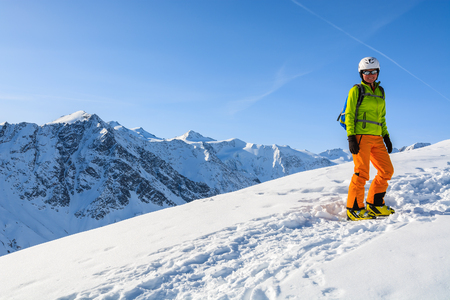 RIFFELSEE SKI RESORT, AUSTRIA - MAR 30, 2014: Woman skier on ascent path in the mountains of Riffelsee winter resort, Austrian Alps. Editorial