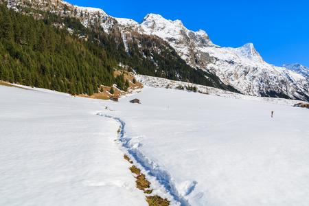 Path in fresh snow in Pitztal valley in spring season, Austrian Alps Stock Photo