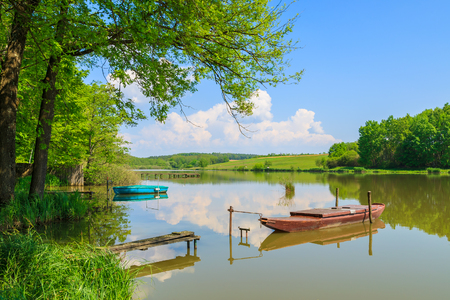 Boat on a lake in countryside landscape in spring, Burgenland, southern Austria
