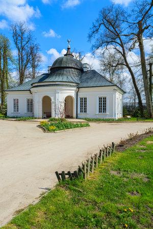 Historic orangery building in Kurozweki palace park, Poland