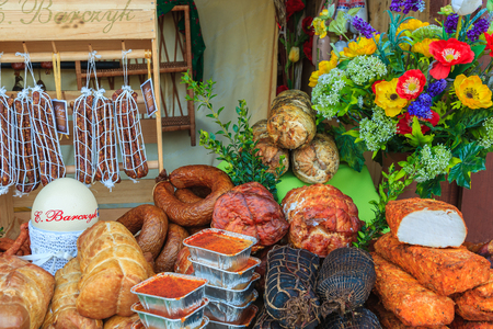 KRAKOW, POLAND - APR 13, 2014: traditional meat products on Easter market stand in Krakow . Many different kinds of traditional meat such as ham and sausages can be bought here each year.