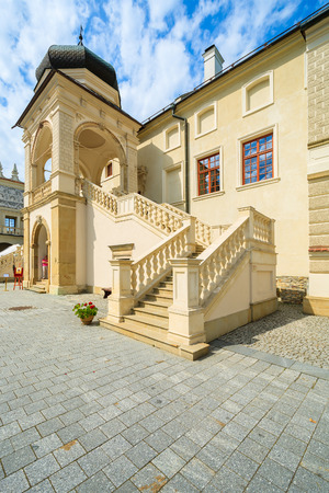 KRASICZYN CASTLE, POLAND - AUG 3, 2014: Courtyard of Krasiczyn castle on sunny summer day. Festival of Japanese culture takes place here every August. Editorial