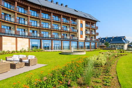ARLAMOW HOTEL, POLAND - AUG 3, 2014: green garden in Arlamow Hotel. This luxury resort was owned by Polands government and is located in Bieszczady Mountains.