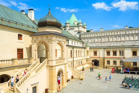 KRASICZYN CASTLE, POLAND - AUG 3, 2014: courtyards of beautiful castle during summer fairs in Krasiczyn town, Poland. 新闻类图片