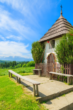 Small chapel in rural summer landscape, Lapszanka, Tatra Mountains, Poland