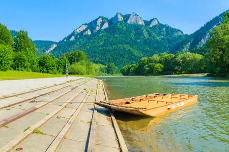 Wooden rafting boat on shore of Dunajec river, Trzy Korony, Pieniny Mountains, Poland