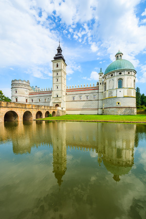 Reflection of beautiful Krasiczyn castle in a lake on a sunny summer day, Poland Editorial