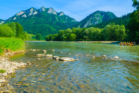 Dunajec river and tourist boat on water in the distance, Beskid Niski Mountains, Poland