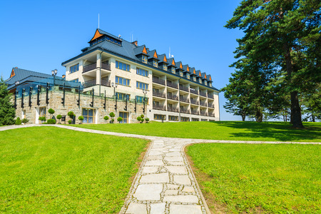 ARLAMOW HOTEL, POLAND - AUG 3, 2014: beautiful hotel building on sunny summer day in Arlamow Hotel. This luxury resort was owned by Polands government and is located in Bieszczady Mountains.