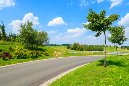 Scenic country road to golf playing area in Paczultowice village near Krakow on sunny summer day, Poland Stock Photo