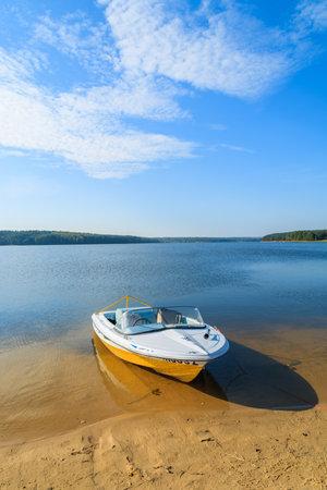 CHANCZA LAKE, POLAND - OCT 4, 2014: motor boat on shore of beautiful Chancza lake. Water sports are becoming more and more popular among Polish people. Sajtókép
