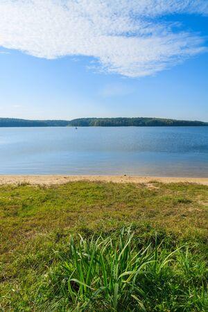 Green grass on shore of Chancza lake, Poland Stock Photo