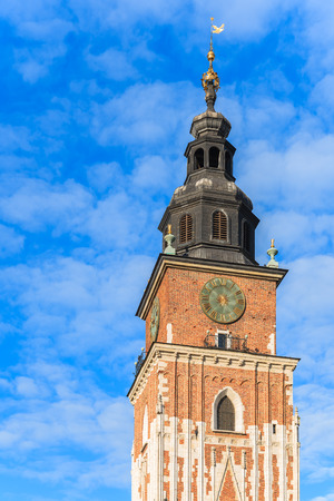 City Hall tower against blue sky on main market square of Krakow, Poland
