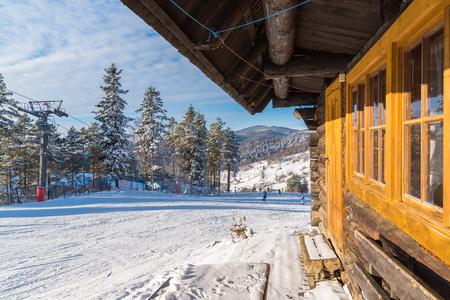 Mountain hut in Wierchomla ski area on sunny winter day, Poland