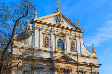Facade of saint Peter and Paul church in Krakow lit by afternoon sun, Poland Stock Photo