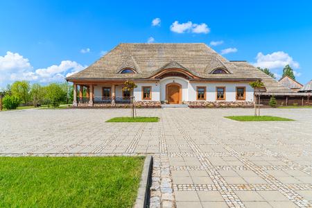 TOKARNIA VILLAGE, POLAND - MAY 12, 2016: traditional restaurant building in Tokarnia village on sunny spring day, Poland.