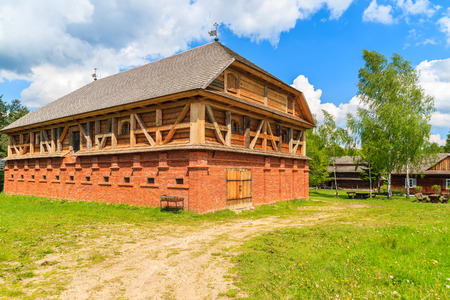 Old traditional mill building in Tokarnia village on sunny spring day, Poland
