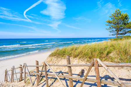 Entrance to beautiful sandy beach in Bialogora coastal village, Baltic Sea, Poland
