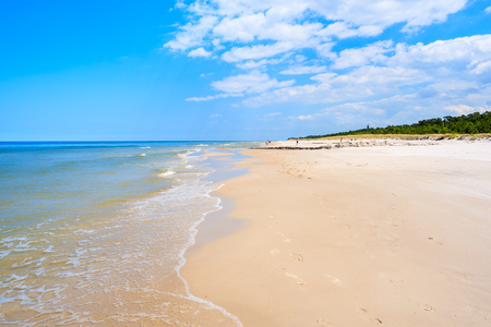 Sea waves on white sand Debki beach, Baltic Sea, Poland 스톡 콘텐츠