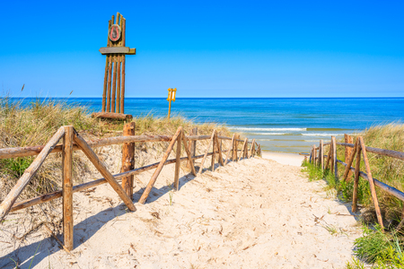 Entrance to sandy beach on coast of Baltic Sea near Lubiatowo village, Poland