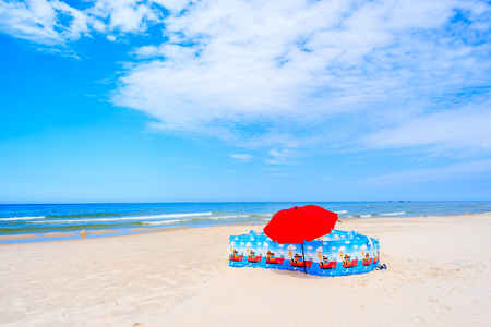Umbrella and on Leba beach, Baltic Sea, Poland Stock Photo