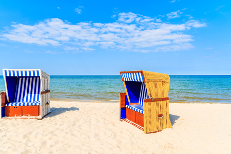Colourful wicker chairs on sandy Jurata beach, Baltic Sea, Poland