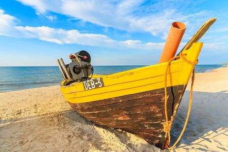 DEBKI BEACH, POLAND - JUN 22, 2016: traditional fishing boat on sandy beach in Debki coastal village, Baltic Sea, Poland.