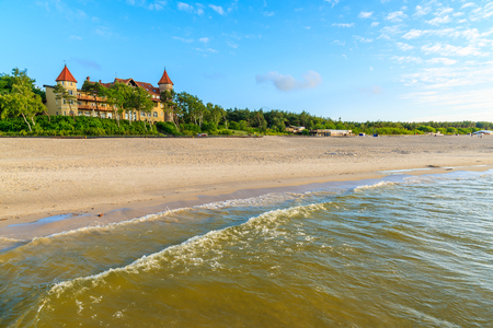 A view of Leba beach and historic hotel building on sand dune, Baltic Sea, Poland