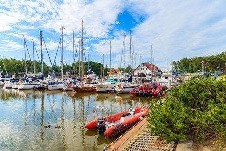 LEBA PORT, POLAND - JUN 21, 2016: sailing boats mooring in small Leba port on coast of Baltic Sea, Poland. Editorial