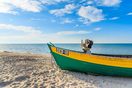 DEBKI BEACH, BALTIC SEA - JUN 22, 2016: typical colourful fishing boat on Debki beach on sunny beautiful summer day, coast of Baltic Sea, Poland. Editorial