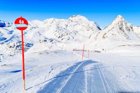 Red sign marking ski ride around whole Obertauern area Tauernrunde, Austria