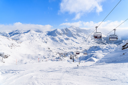 View of chairlifts and beautiful winter scenery in Obertauern ski resort, Austria
