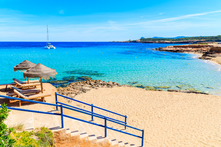 Steps to Cala Comte beach with golden colour sand, Ibiza island, Spain Stock Photo