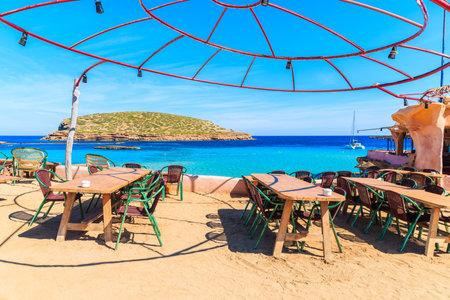 CALA COMTE BAY, IBIZA ISLAND - MAY 17, 2017: Coastal restaurant with beautiful sea view on Cala Comte beach, Ibiza island, Spain.