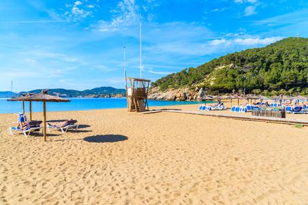 Lifeguard tower and sandy beach in Cala San Vicente bay, Ibiza island, Spain