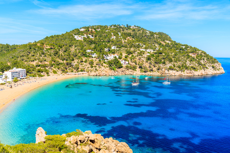 View of beautiful Cala San Vicente bay with azure sea water and beach, Ibiza island, Spain