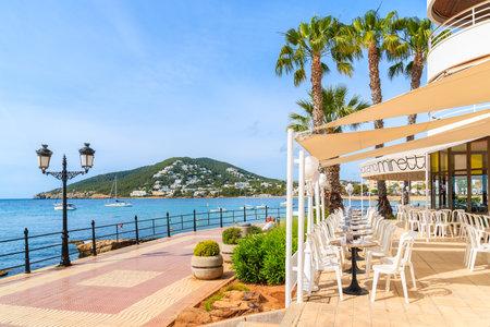 IBIZA ISLAND, SPAIN - MAY 21, 2017: Restaurant on coastal promenade along sea in Santa Eularia town, Ibiza island, Spain. Editorial