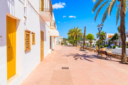 Typical Spanish style houses and palm trees on street of Sant Josep de sa Talaia town, Ibiza island, Spain