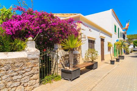 IBIZA ISLAND, SPAIN - MAY 19, 2017: Typical Spanish style houses on street of Sant Josep de sa Talaia town, Ibiza island, Spain.