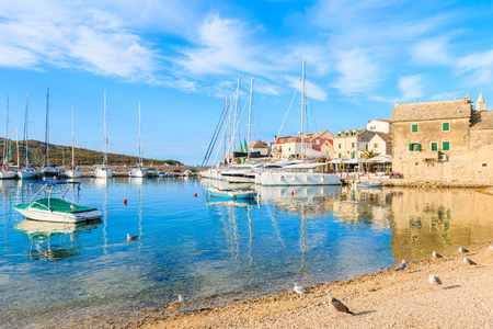 View of beach and sailing boats anchoring in Primosten port, Dalmatia, Croatia