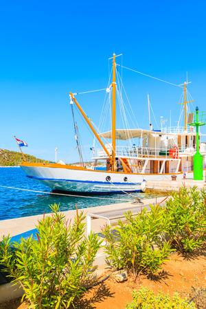 Beautiful traditional sailing boat anchoring in Rogoznica port, Dalmatia, Croatia